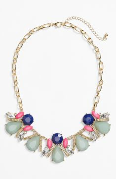 Adore this stone cluster frontal necklace. It has the perfect mix of sparkly crystals and colorful stones.