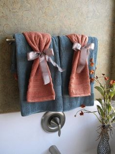 tons of ideas on displaying coffee table, bath towels, and bedroom!-towel display for guest bathroom Coral Bathroom Decor, Bathroom Towel Decor, Bathroom Ideas, Bath Decor, Decorative Bathroom Towels, Bathroom Accessories, Bath Ideas, Peach Bathroom, Budget Bathroom