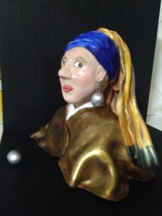"""My 3-D version of """"The girl with a pearl earring"""", by Vermeer. She is a 17th century girl so she has aged a bit in her transition to clay from paint. Created by Michelle Castro"""