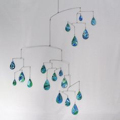 Hand painted mobile resembling raindrops - great for a stairway, over a table or counter, or above a crib