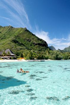 Moorea, French Polynesia | Resembling a watercolor painting, the crystal blue lagoons juxtaposed with the verdant peaks of the surrounding mountains will transform all of your senses.