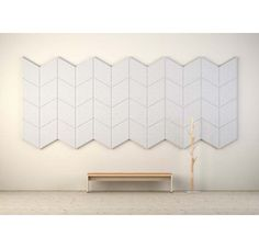 Define your waiting room or lobby with a wall of sound absorbers.