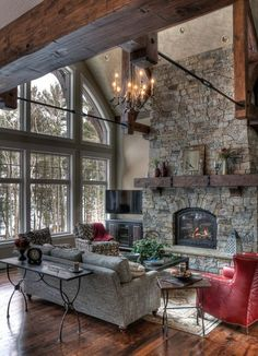 Living room, great room, dark rustic wood floors, stone fireplace, orb chandeliers, horse art