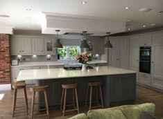 Grey bespoke kitchen, cornforth white and plummet paint, Cox and Cox wooden stools, honey oak van goth flooring. Kitchen Diner Extension, Open Plan Kitchen Diner, Open Plan Kitchen Living Room, Kitchen Dining Living, Kitchen Family Rooms, Home Decor Kitchen, Kitchen Interior, New Kitchen, Kitchen Design