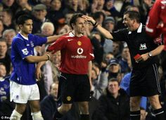 Neville is ordered off the pitch after being sent off by Phil Dowd during a game against Everton