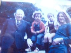 Robert Plant and his grandfather with children Karac Pendragon and Carmen Jane.