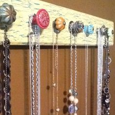 Necklace holder :) LOVE this!!!! :) Cute idea with different style and color knobs