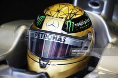 Michael Schumacher of Germany and Mercedes GP prepares to drive wearing a specially designed gold drivers helmet as he commemorates the 20th anniversary of his first F1 race during practice for the Belgian Formula One Grand Prix at the Circuit of Spa Francorchamps on August 26, 2011 in Spa Francorchamps, Belgium.