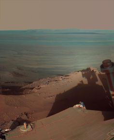 Late Afternoon Shadows at Endeavour Crater on Mars Opportunity returned this postcard-perfect shot of her own shadow extending into Endeavour crater on sol 2888 (March 9, 2012). NASA / JPL / Cornell