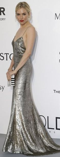 Sienna Miller: Dress – Ralph Lauren  Earrings – Atelier Swarovski