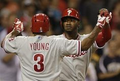 Philadelphia Phillies' Domonic Brown, right, and teammate Delmon Young (3) celebrate Young's two-run home against the San Diego Padres during the eighth inning to tie the game in a baseball game Wednesday, June 26, 2013, in San Diego. (AP Photo/Gregory Bull)