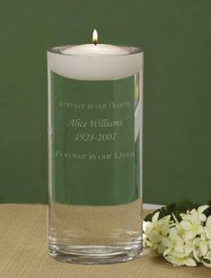 Our Floating Memorial Candles are then filled with water and the included white floating candle sits suspended above the engraving, glowing throughout the funeral or memorial service.