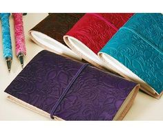 Embossed leather notebook. *** would totally love one of these!