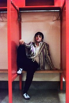 John Lennon relaxes backstage at Shea Stadium on August 24, 1966.