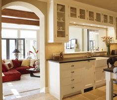 cutout between the rooms is another way to get that open floor plan without the expense of removing a wall