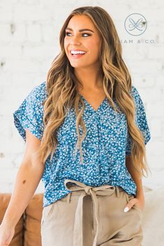There are so many things we love about our Dorthy Floral Wrap Top! From the trendy floral print and the v-neck wrap around fit, to the elastic hem, short sleeves, and high-low hem, what's not to love? Our top is so comfortable and easy to move around in! Wear it with your favorite jeans or a fun skirt for the perfect outfit!
