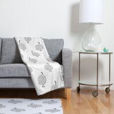 Kangarui Guinea Fowls On Safari Fleece Throw Blanket | DENY Designs Home Accessories #guineafowl #blanket #homeware #blackandwhite