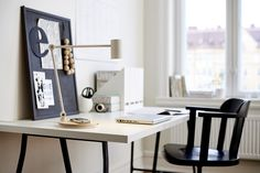 A home office with a work lamp with wireless charging standing on a desk by IKEA Ikea Living Room Furniture, New Furniture, Table Furniture, Ikea Wireless Charging, Ikea New, Work Lamp, Task Lamps, Workspace Inspiration, Piece A Vivre