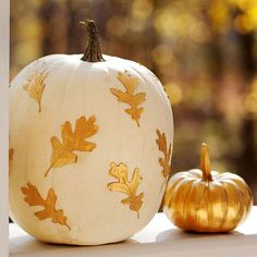 {Gold Leaf Pumpkin} -Collect fallen leaves and spray-paint them gold; let dry. Paint one pumpkin white and the other gold. When dry, use crafts glue to attach the metallic leaves to the white pumpkin, then arrange the pair together on your porch or front step.