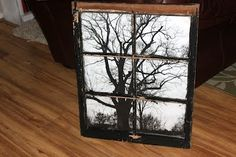 "Antique window sash with an inexpensive ($2.99!!) ""engineer's print"" made at Staples print center from her photo disk, then tape to back of window frame. Very impressive!"