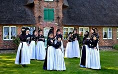 Performers In Traditional Costumes In Front Of Oeoemrang Hus History Museum,village Of Nebel,Amrum,North Frisia,Schleswig-Holstein,Germany,Europe Stock Photos / Pictures / Photography / Royalty Free Images at Inmagine