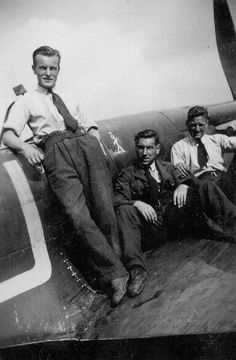 """A trio of fitters from No 92 Squadron RAF at RAF Biggin Hill in 1940 shows LAC Eric Barnes at the centre on the starboard wing of Spitfire Mk I QJ-U flown by P/O Thomas BA """"Jock"""" Sherrington and emblazoned with the stick figure created by Eugene Hastain for the 1930 adventure stories Enter the Saint by Leslie Charteris. The 21-year-old aircraftman transferred from No 19 Squadron RAF in October 1939, having joined the service on 12 July 1938."""