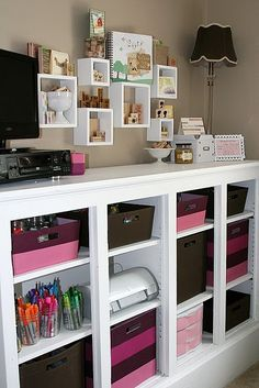 Cute organized creative space. Love the cubbies hanging in the wall. Great display.