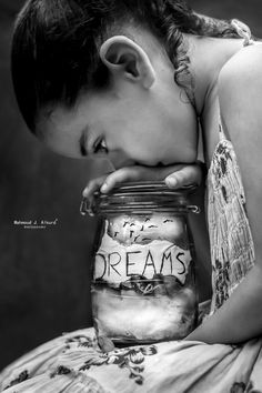 Girl holding dreams in a jar,  children's photography,