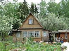 I love the windows on this Russian country house (dacha). Nice garden, too.