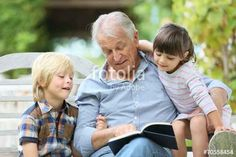 """Download the royalty-free photo """"Senior man reading book with grandkids"""" created by goodluz at the lowest price on Fotolia.com. Browse our cheap image bank online to find the perfect stock photo for your marketing projects!"""
