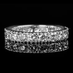 Find This ring at http://www.thebuccicollection.com/#!shoot002-17wb/cq56  This Gorgeous Bucci Set Platinum Wedding Band has a Total Diamond Weight of .75 Carat's, G Color and VS Clarity. This Ring is a part of our Siempre Amor Collection.