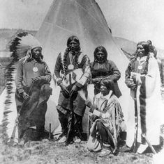 Utah Indians | Ute Indians posing in front of a tipi.