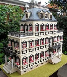 This is a custom-made house by a playmobil enthusiast.  I would love to have the time (and unlimited money) to do something so fun!
