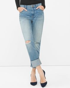 """The new boyfriend: makes your legs look longer thanks to a higher rise and slimmer, straighter cut. The right-now length looks even better with the easy rolled cuff and destruction. Its perfect match is a half-tucked tee and pointy heels.   Destructed boyfriend jeans Sits just below the waist Button fly front; belt loops  5-pocket style with goldtone hardware Wear the hem rolled or straight Regular: Approx. inseams: 26 ½"""" short, 29"""" regular, 31"""" long Petite: Approx. inseam unrolled: 27"""" and…"""