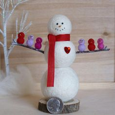 Flock Full of LOVE! This snowman is needle felted from beautiful natural white wool roving. He is a lucky snowman with lots of love in his life....look how many friends have stopped by! He is all dressed up for Valentines Day with his red scarf and sparkling red heart. His six