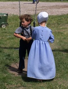 amish children at a quilt auction.