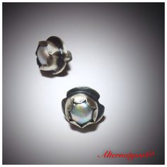 Botones de perla engastada en plata .925