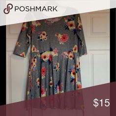 A casual Justice grey dress Great condition, comfortable, worn about 3 times. Looks like new. 95% polyester 5% elastane. Heather grey with bright floral pattern Justice Dresses Casual