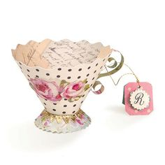 DIY Paper Teacup Bunting Tutorial on Vintage Follie at http://vintagefollie.blogspot.com/2013/04/teacup-bunting.html