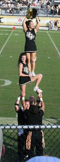 UCF Cheerleading 2007. Me holding Lauren.