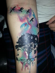 watercolor thigh tat