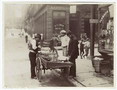 Clam seller in Mulberry Bend, New York. NYPL Digital Gallery.