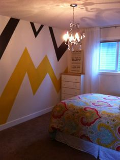 love that funky chevron on one wall design - bold colors - great for media room