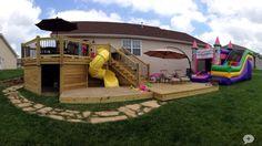 playhouse under deck | Deck with slide, sandbox, and playhouse