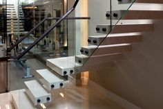 We were asked to provide enhanced access and a luxurious finish to a personal basement gym in Chelsea, London. The designs were carefully considered, bold and strong yet not too masculine with lighter colours and well chosen materials. The finished basement staircase installation is this wonderful open tread staircase finished in marble on the stair, …