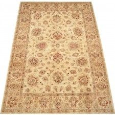 Beautifully hand knotted wool oriental rug. This beige, gold area rug has a beautiful antique design and will be a wonderful addition to your home decor' or a beautiful starting point for decorating your new home. This handmade oriental rug is made to last a good long while and bring warmth and comfort to any room in your home. Neutral color for a variety of options.