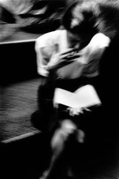 Trent Parke, An office worker in Pitt Street Mall reads a book in the lunch hour. 1999.