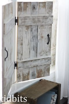 Interior Window Shutters - handmade shutters, hinged together - an inexpensive alternative to pricey custom-made window coverings. This post has the info on how to get this great paint finish - via Tidbits