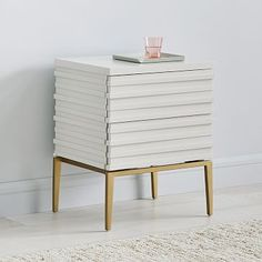 The sophisticated, stacked silhouette of our Martina nightstand brings textural dimension to polished lacquer. The sleek exterior conceals two push-touch drawers to hold all your bedside essentials. With its tapered brass legs, it could make a chi… European Furniture, Modern Furniture, Furniture Design, Plywood Furniture, Furniture Sale, Furniture Ideas, Mod Living Room, Oversized Furniture, Bedding Shop