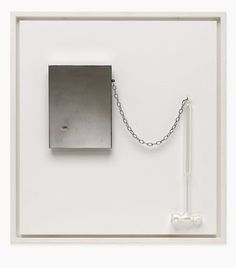 Yoko Ono: Painting to Hammer a Nail in- A glass hammer attached with a chain to a steel plate pierced by nail.
